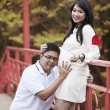 Happy expecting pregnant Asian couple — Stock Photo