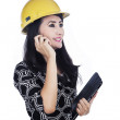 Architect holding cellphone and tablet — Stock Photo