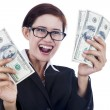 Businesswoman holding dollar bills — Stock Photo