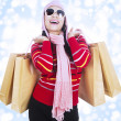 Excited shopper in winter season — Stock Photo