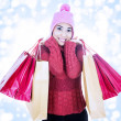 Happy shopper carrying pink bags — Stock Photo