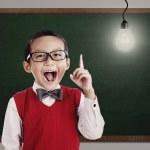Elementary School Student with Bright idea — Stock Photo #13796744