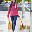 Cheerful shopper with brown shopping bags — Stok fotoğraf