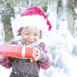 Happy toddler holding Christmas gift — Stock Photo