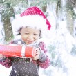 Happy toddler holding Christmas gift — Stock fotografie