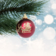 Christmas bauble hanging on pine tree — Stock Photo