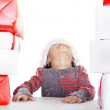 Girl looking up for Christmas gifts — Stock Photo