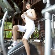 Asian woman working out in gym — Stock Photo