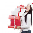 Royalty-Free Stock Photo: Christmas gifts from girl with Santa hat