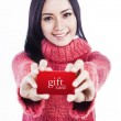 Excited woman showing gift card — Stock Photo