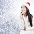 Thoughtful christmas woman — Stock Photo