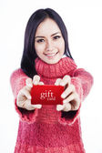 Excited woman showing gift card — Foto de Stock