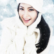 Beautiful woman in white winter clothes on blue defocused lights — Stock Photo #14466023