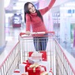 Christmas gift shopping at the mall — Stock Photo