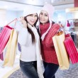 Happy winter shopping in mall — Stock Photo