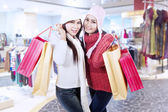 Happy winter shopping in mall — Stok fotoğraf