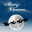 Christmas card design Santa riding deers on full blue moon — Stock Photo