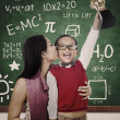 Stockfoto: Preschooler wins Math competition holding trophy kiss by mum