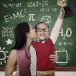 Preschooler wins Math competition holding trophy kiss by mum — Foto de stock #14728513