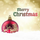 Christmas decoration and greeting in golden lights — Stock Photo