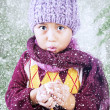 Boy is freezing in cold winter under tree — Stockfoto