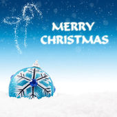 Christmas decoration and greeting in blue lights — Stock Photo