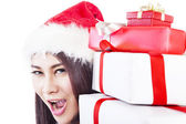Expression of happy woman with christmas gift — Stock Photo