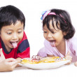 Dinner time with brother and sister isolated — Stock Photo