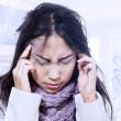 Terrible headache in winter — Stock Photo