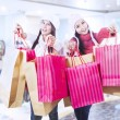 Winter shopping with friends at mall — Stock Photo