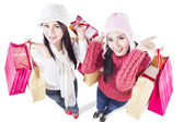 Happy holiday shopping in winter with friends-isolated — Stock Photo