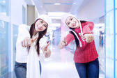 Happy sisters on success in the office — Stock Photo