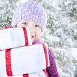 Boy carry christmas gifts on snow background — Stock Photo