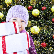 Boy with christmas gifts under tree — 图库照片
