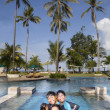 Stock Photo: Happy Asian Family on Vacatiopn