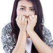 Expression of scared face woman isolated over white - Stock Photo