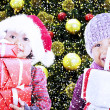 Children bring christmas gifts under tree — Stock Photo #15914663