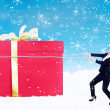 Stock Photo: Businesswomhold christmas gift with chain