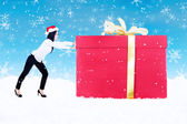 De gift van kerstmis geduwd door vrouw op blauwe achtergrond — Stockfoto