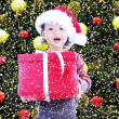 Happy girl receive christmas gift under tree — Stock Photo