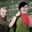 Stock Photo: Beautiful nerd girl and guy in love at school