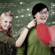 Beautiful nerd girl and guy in love at school - Stock Photo
