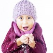 Stock Photo: Boy plays snow with beany in winter isolated in white