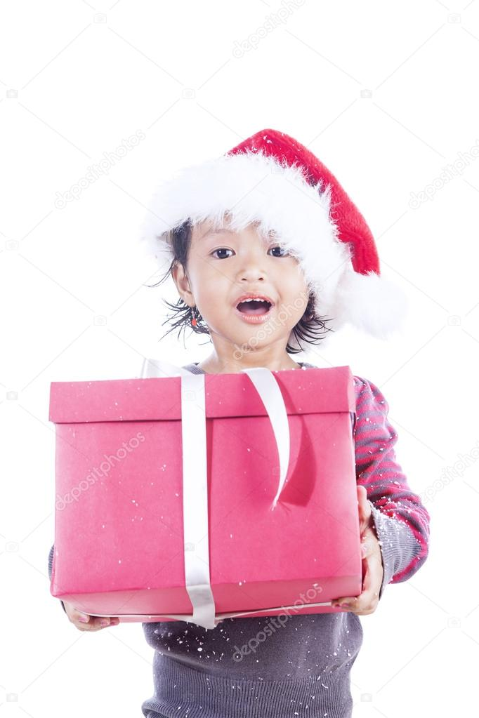 A girl is holding her christmas present, isolated in white — Stock Photo #16278247