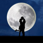 Couple in love on blue full moon silhouette — Stock Photo