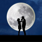Guy kiss girl hand on blue full moon background — Stock Photo
