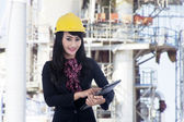 Architect woman with e-tablet at construction site — Stock Photo