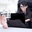 Beautiful businesswoman relaxing in office — Stock Photo