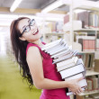 Female student carry books at library — Stock Photo #16728239