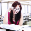 Female student reading with glasses — Stock Photo #16729155